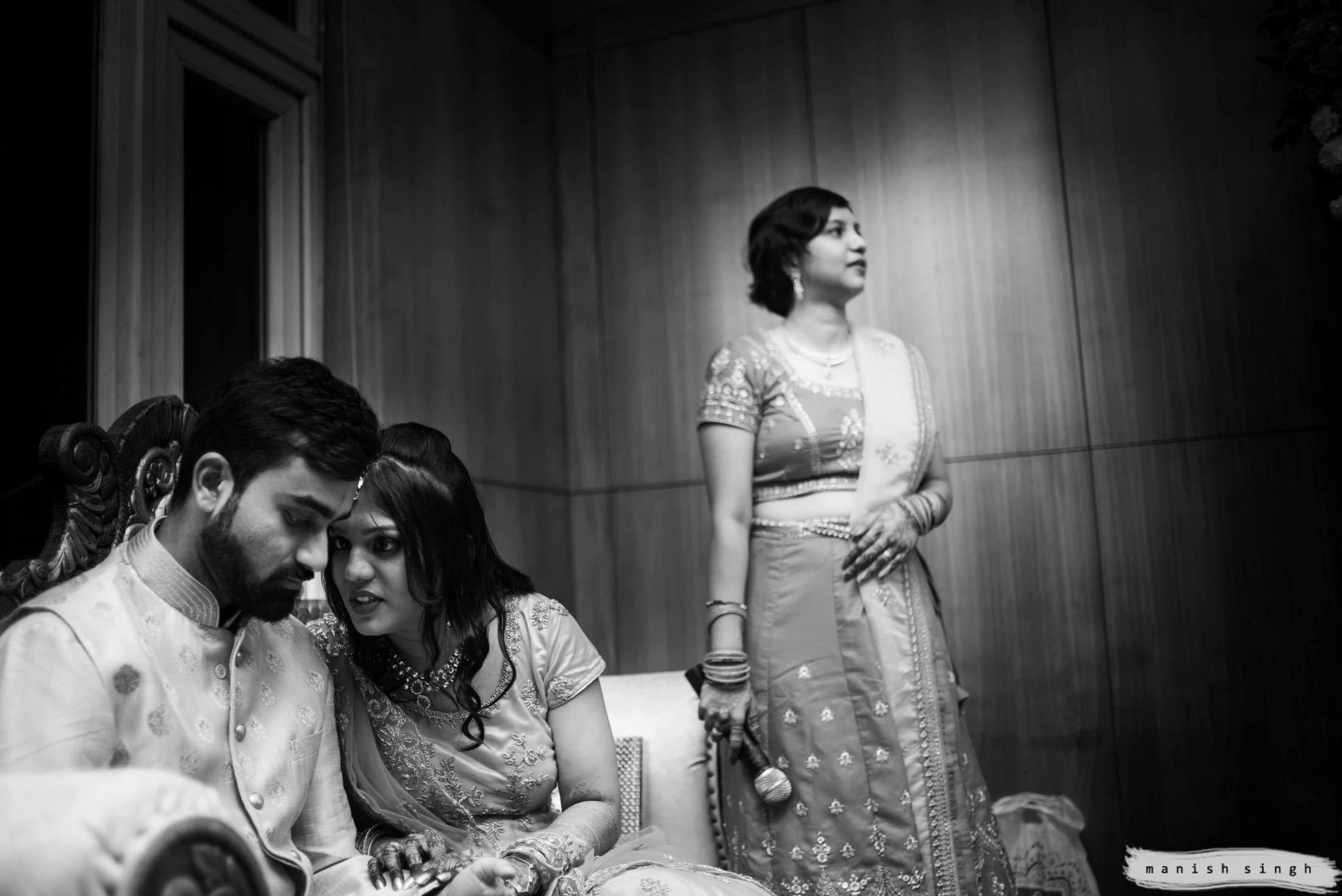 candid moment of bride and groom gossip during wedding