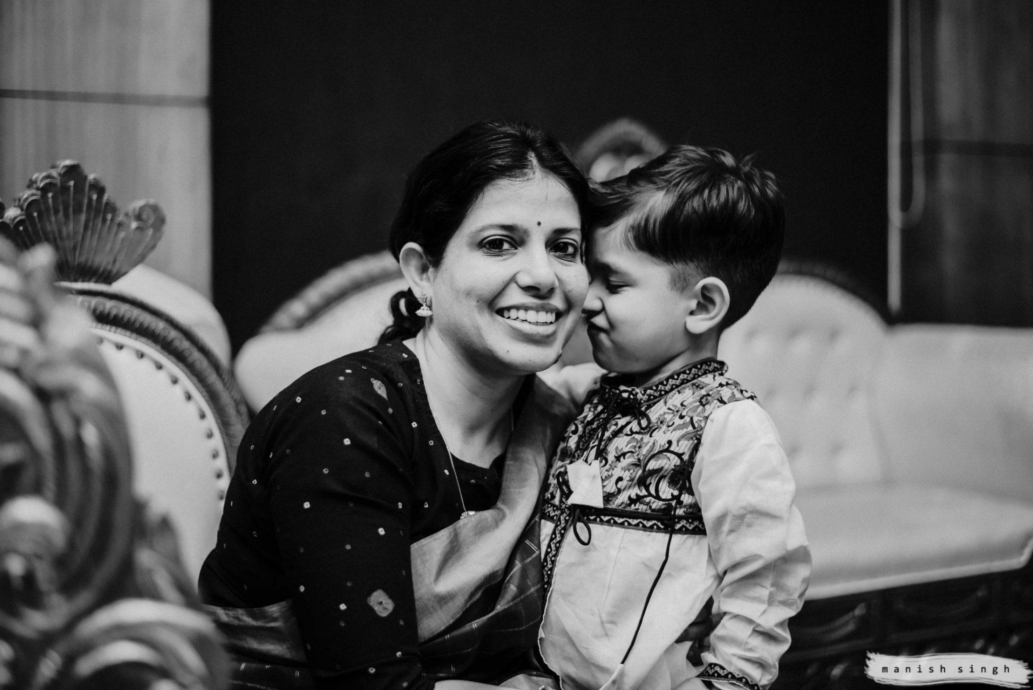 little shy boy with mom in Odisha wedding