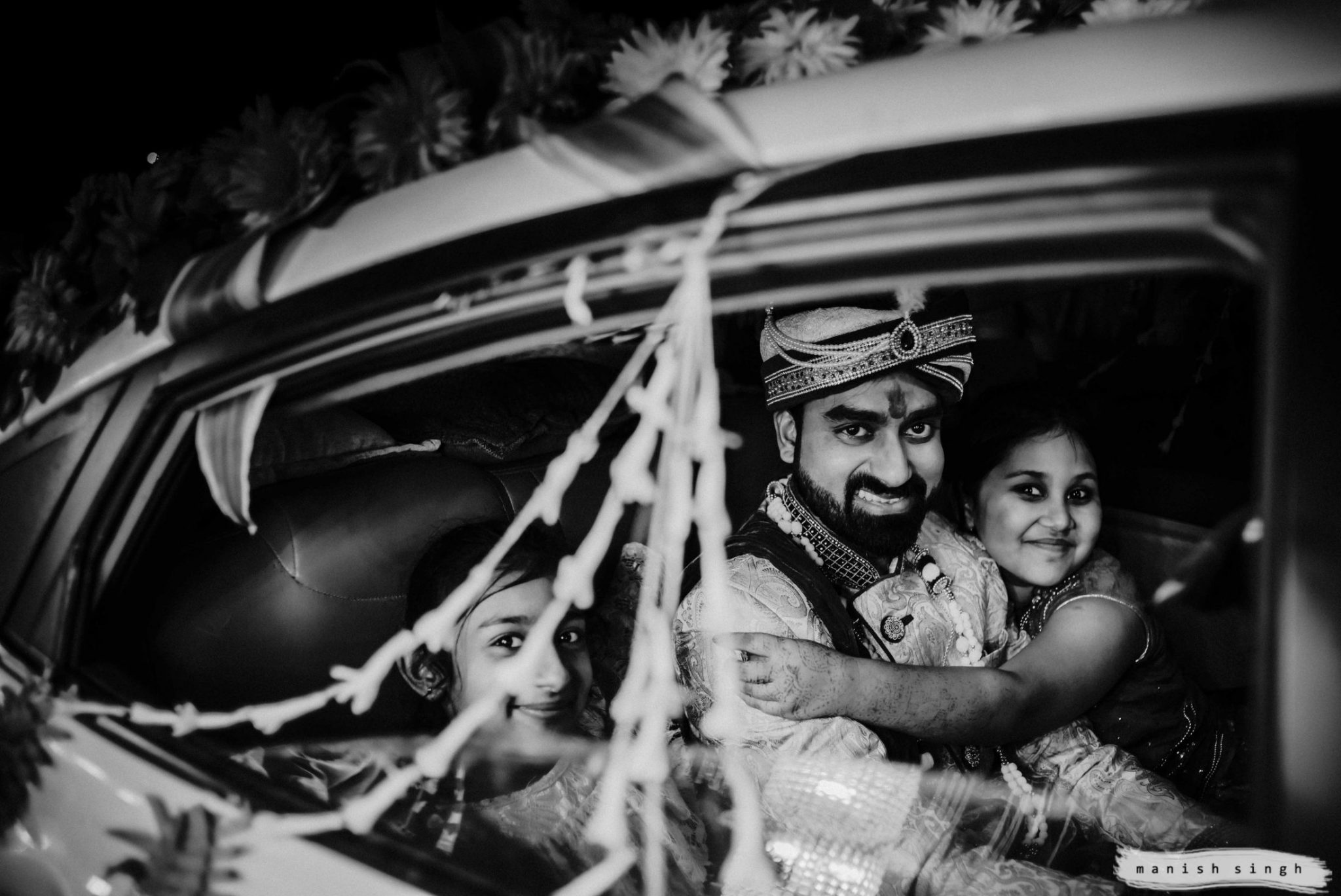 Groom in car during baraat