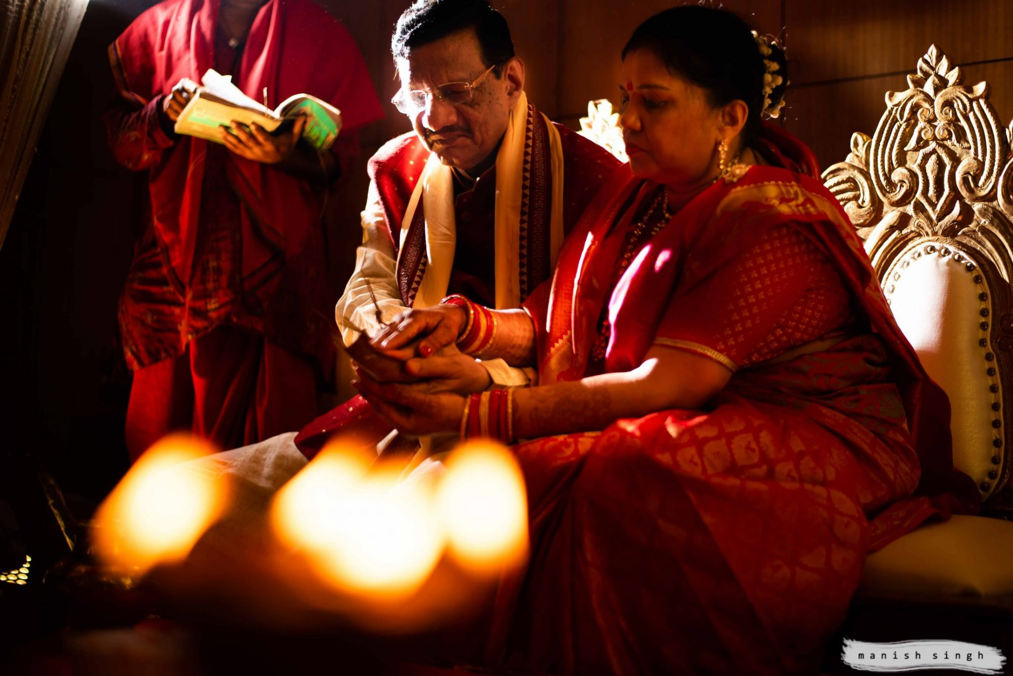 Father and mother performing rituals in Odia wedding