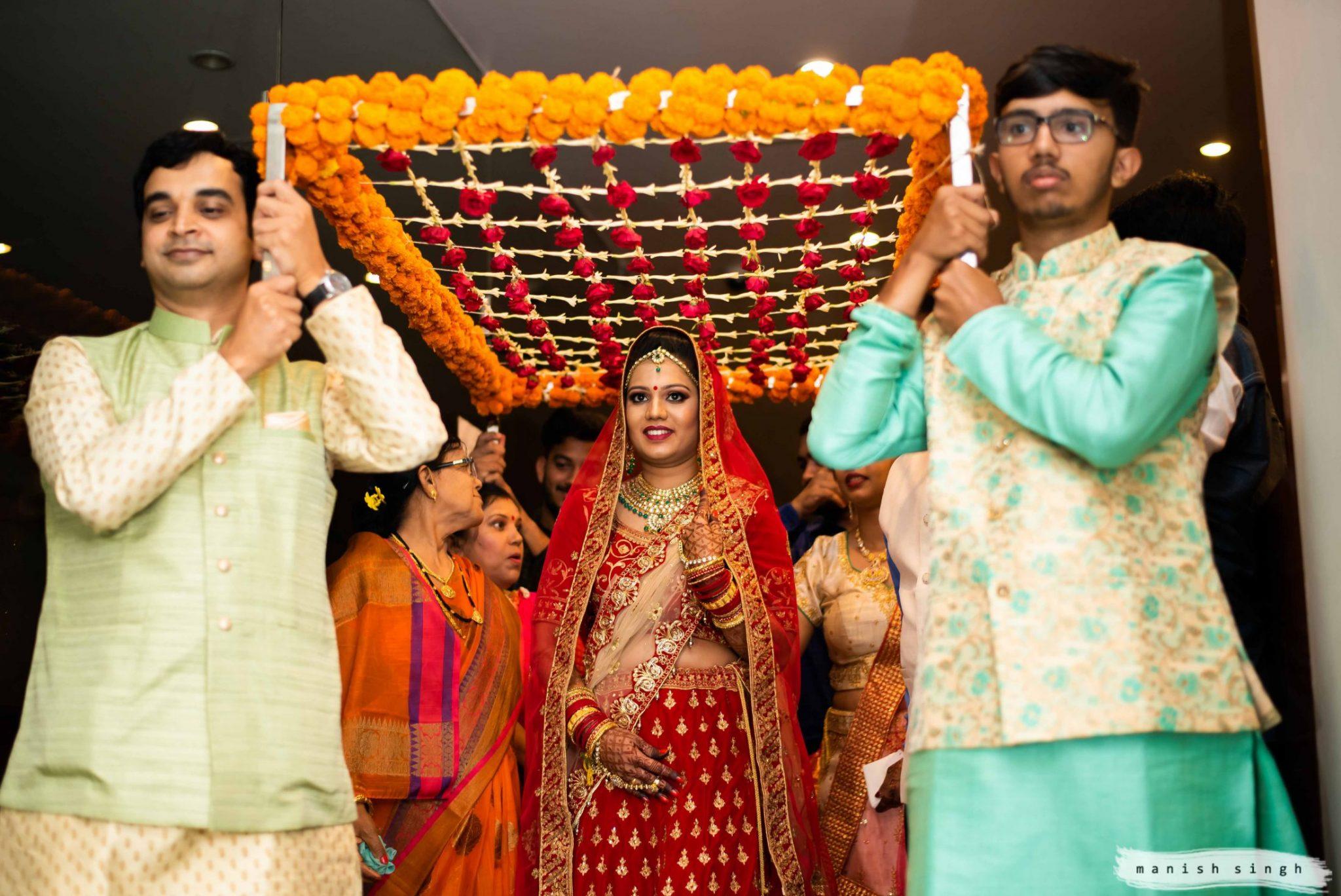 Bridal entry with brother under Phoolon ki Chadar