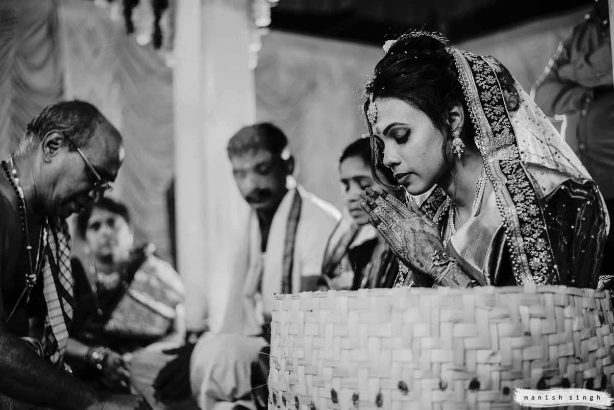 bride prays in mandap with eyes closed during telugu wedding in bhubaneswar