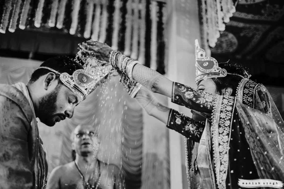 Talambralu a telugu wedding ritual bride putting rice on groom's head
