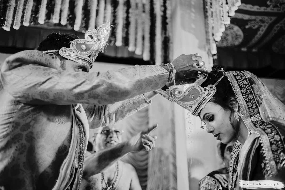 Talambralu a telugu wedding ritual groom putting rice on bride's head