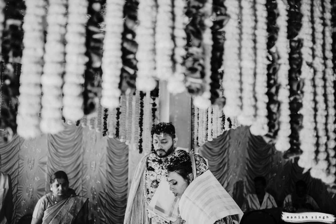 bride and groom standing in mandap