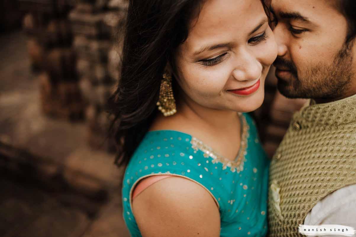 Bride groom intimate closeup moment during pre-wedding shoot at mukteswar temple bhubaneswar